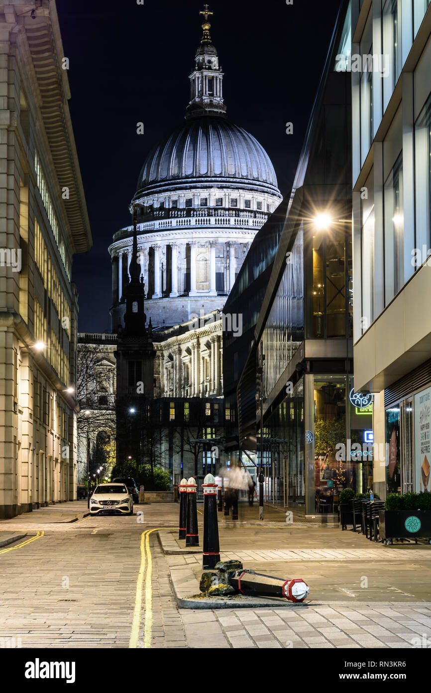 London, England, UK - December 17, 2018: The dome of St Paul's Cathedral rises above St Augustine's Church spire and Watling Street in the City of Lon - Stock Image