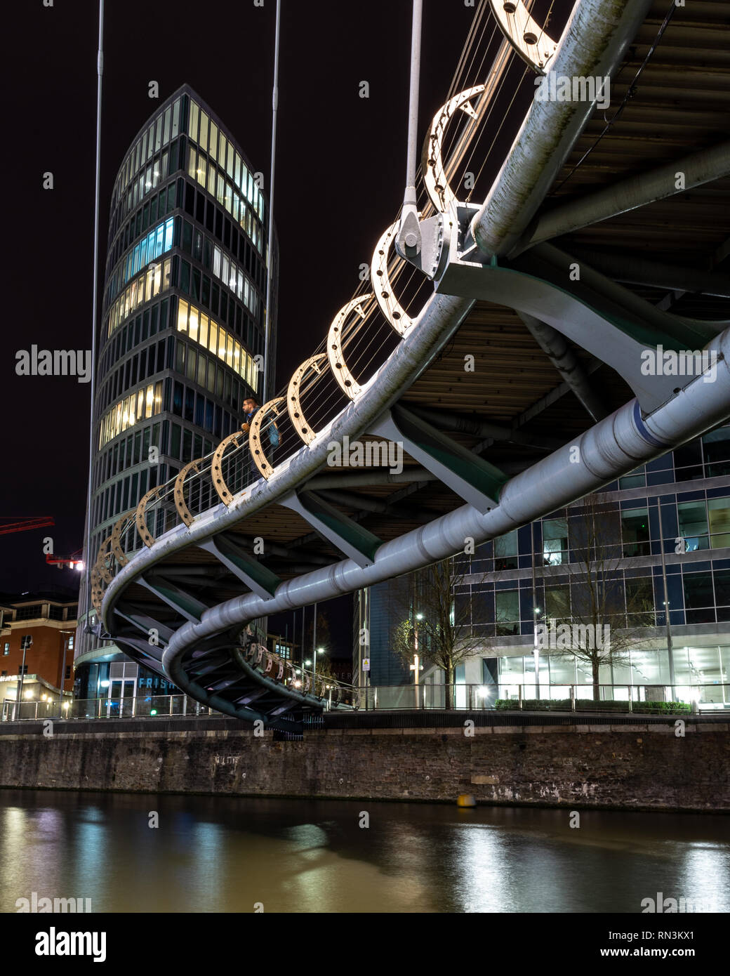 Bristol, England, UK - January 12, 2019: Modern office and apartment buildings are lit at night on Temple Quay, beside Valentine's Bridge on Bristol's - Stock Image