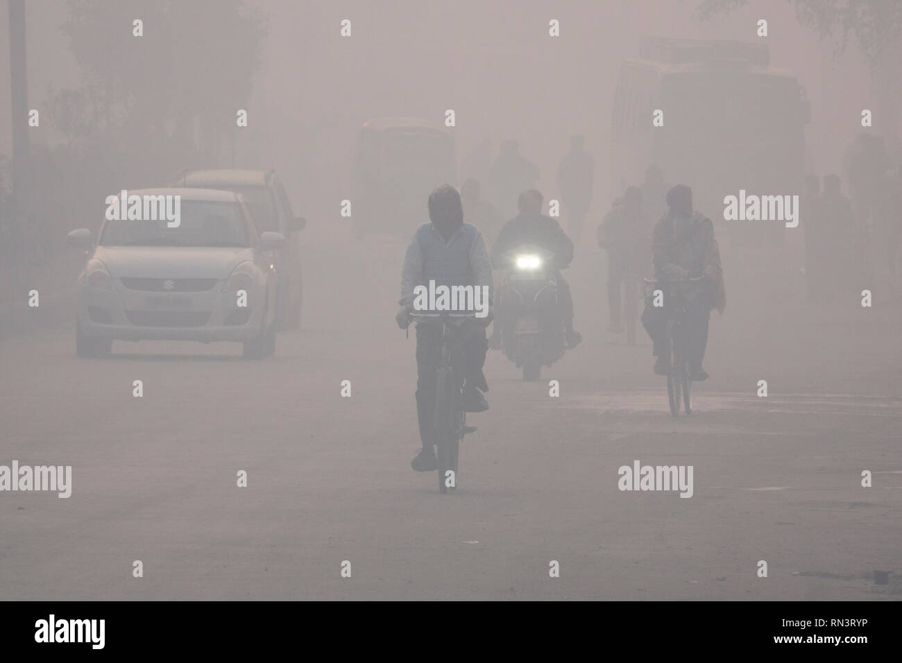 Indian people dealing with dangerous levels of air pollution in Amritsar, Punjab, India - Stock Image