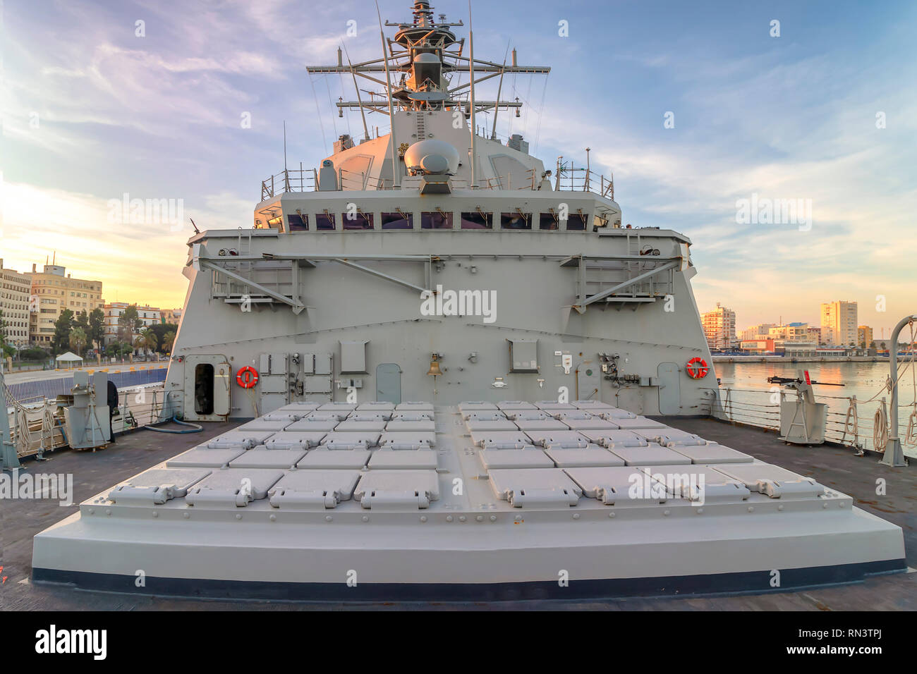 Battleship moored in the Cadiz bay port at sunset with view of Closed mines ballistic nuclear missiles - Stock Image