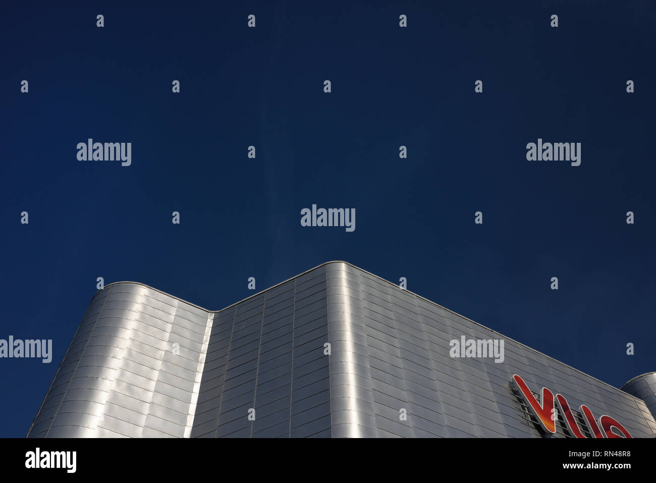 Oblique view of aluminium clad vue cinema against blue sky in the rock triangle retail and leisure development in bury lancashire uk - Stock Image