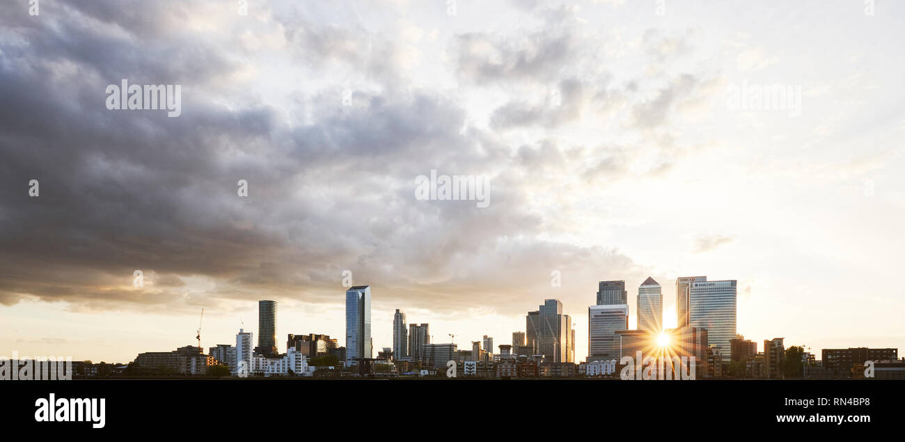 Canary Wharf, Back lit as the sun sets behind the office buildings - Stock Image