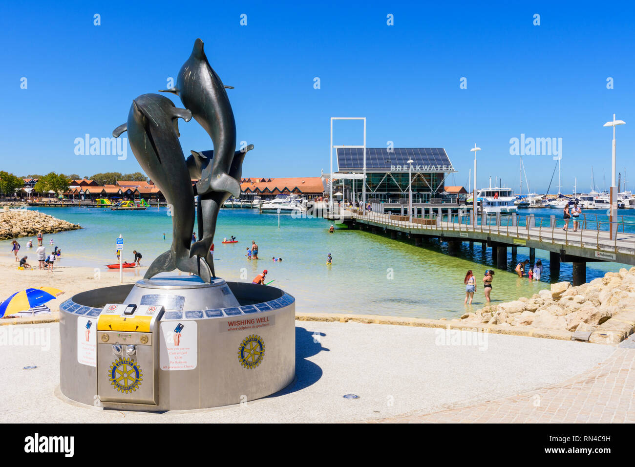 Dolphin wishing well and views over Sorrento Quay at Hillarys Boat Harbour, Hillarys, Western Australia - Stock Image