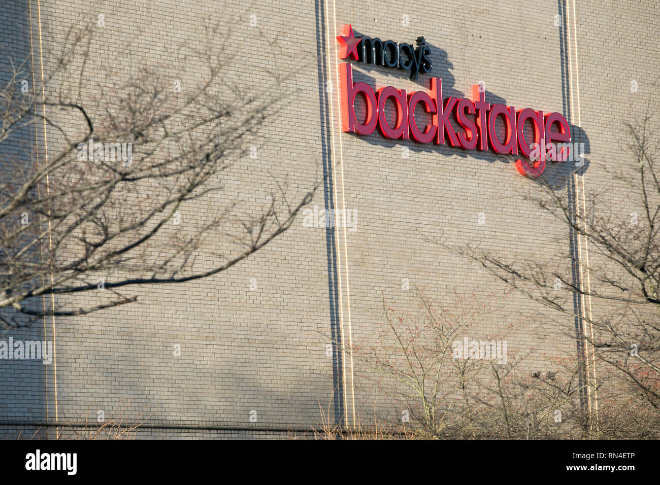 A logo sign outside of a Macy's Backstage retail store location in Dulles, Virginia on February 14, 2019. - Stock Image