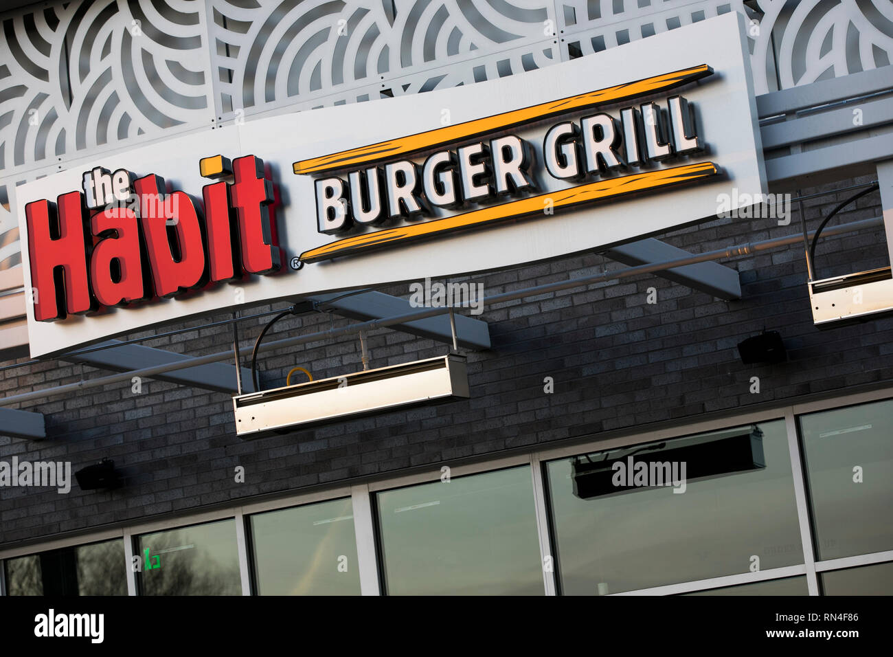 A logo sign outside of a The Habit Burger Grill restaurant location in Chantilly, Virginia on February 14, 2019 - Stock Image
