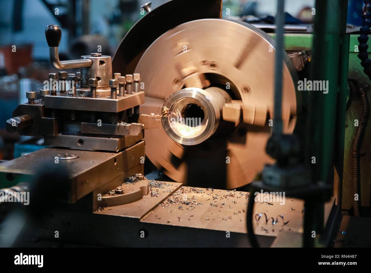 CNC lathe processes metal detail. Automated production. Stock Photo