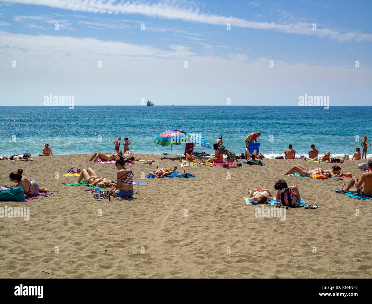 People sun baking at Playa de la Malagueta beach in Malaga, Spain. Stock Photo