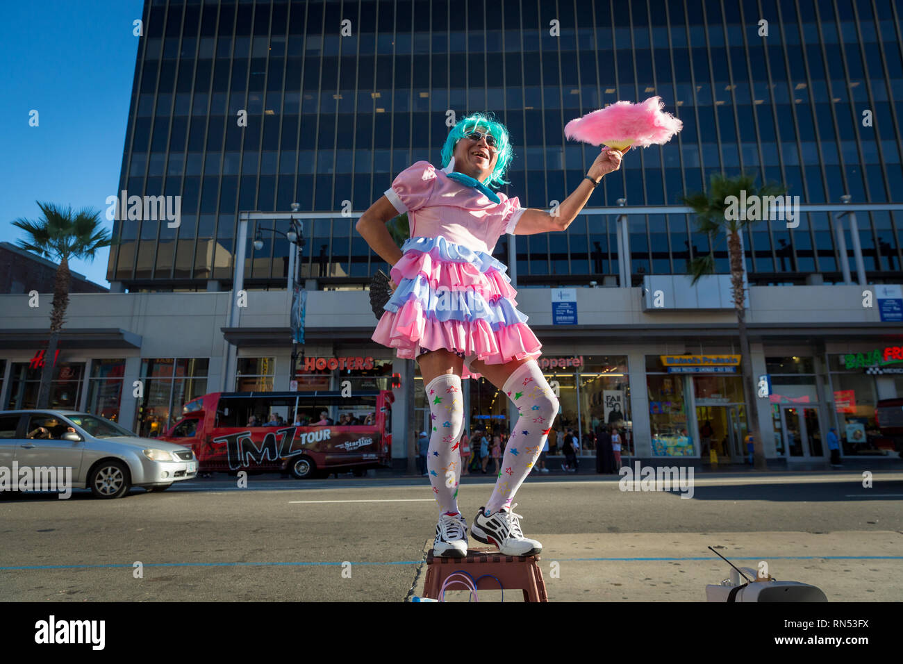 Performer dancing in flamboyant pastel costume on the Hollywood Walk of Fame in Los Angeles, California. - Stock Image