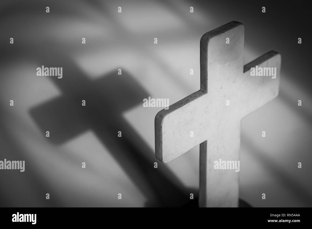Light on the cross and cast a shadow: symbol of the Christian faith - Stock Image