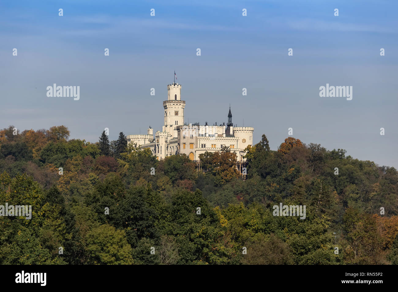 Castle Hluboka nad Vltavou with autumn trees - Stock Image