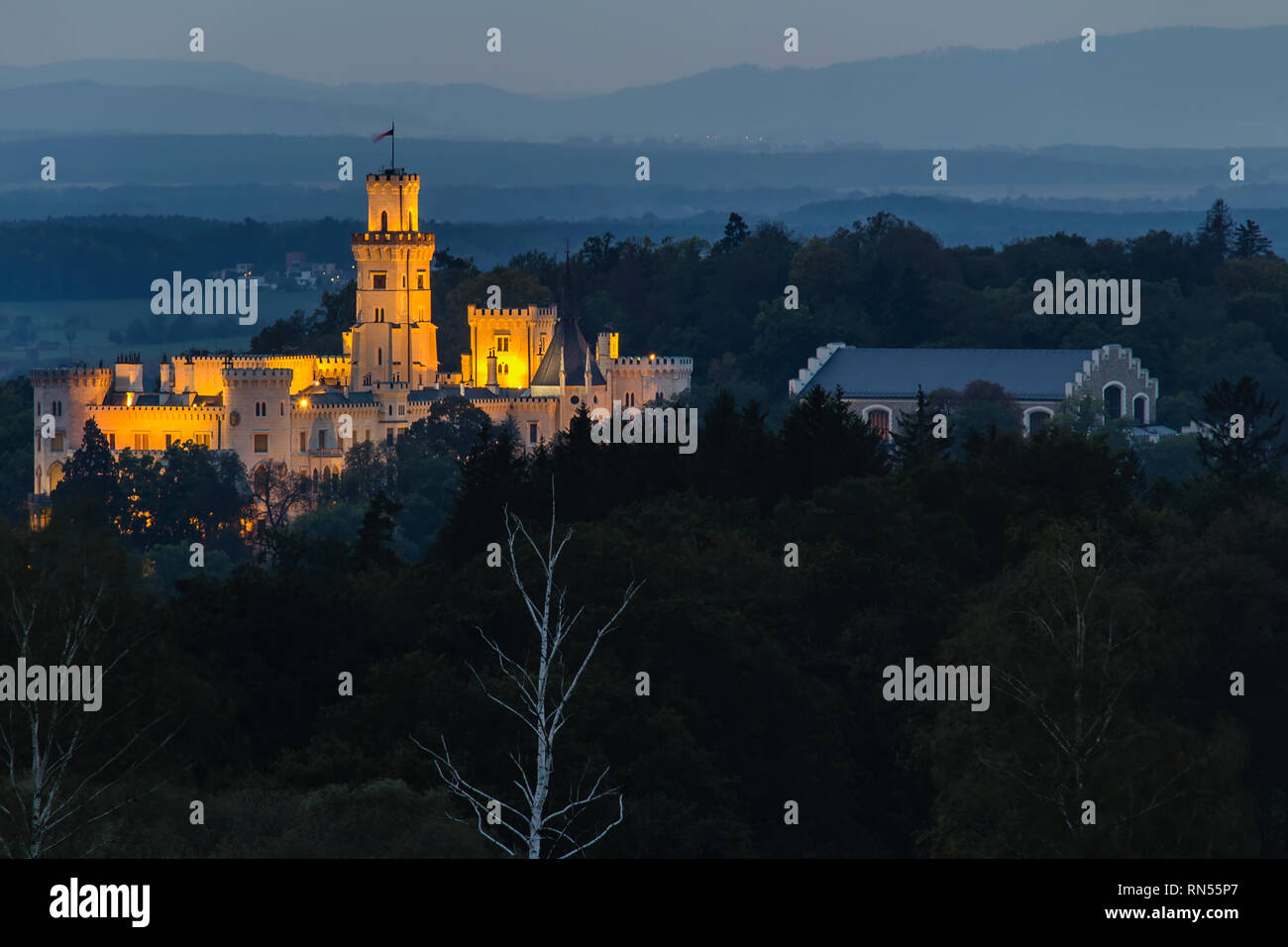 Detail of castle Hluboka nad Vltavou in night with lights - Stock Image