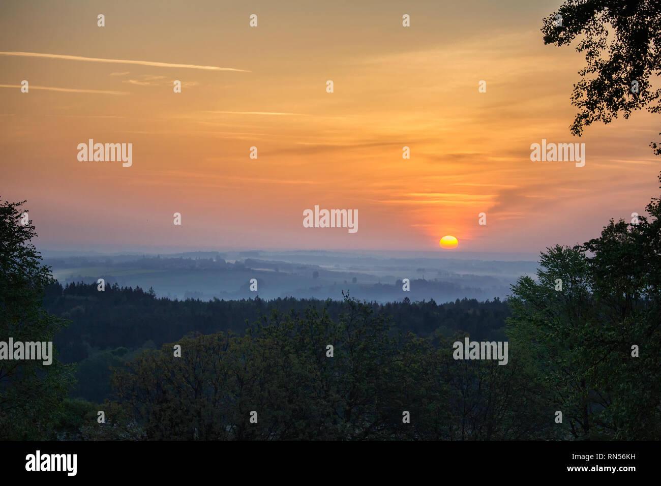 Sunrise over tree and mysty fog. Czech landscape - Stock Image