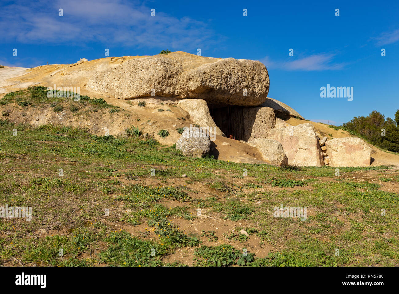 The Dolmen de Menga is in the Spanish town of Antequera. It is a covered gallery dolmen and almost rectangular plant, dating from the 3rd millennium B - Stock Image