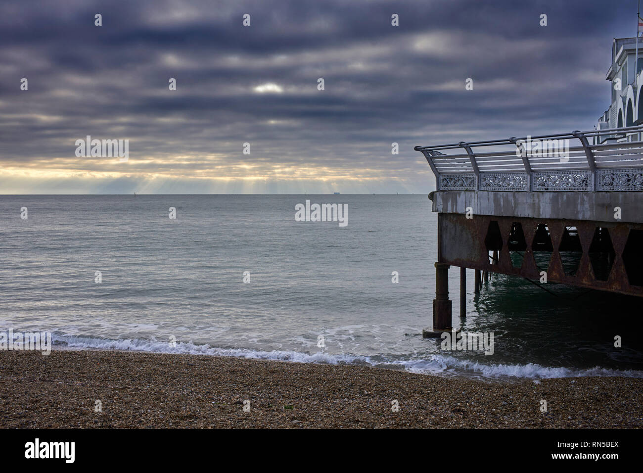 Dark skies over South Parade pier and beach with views over the Solent - Stock Image