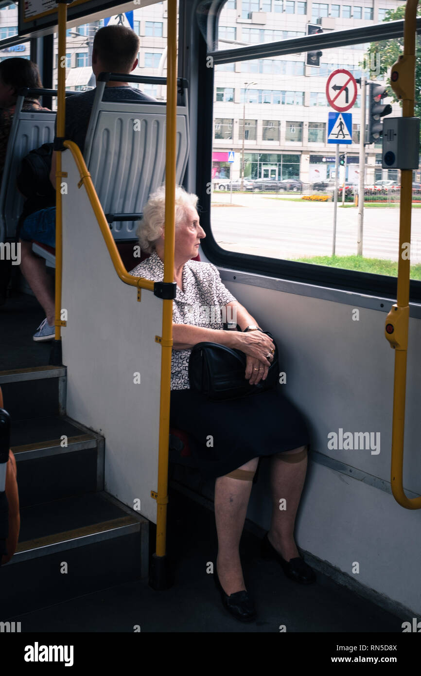 elderly woman on a bus looking out the window Stock Photo