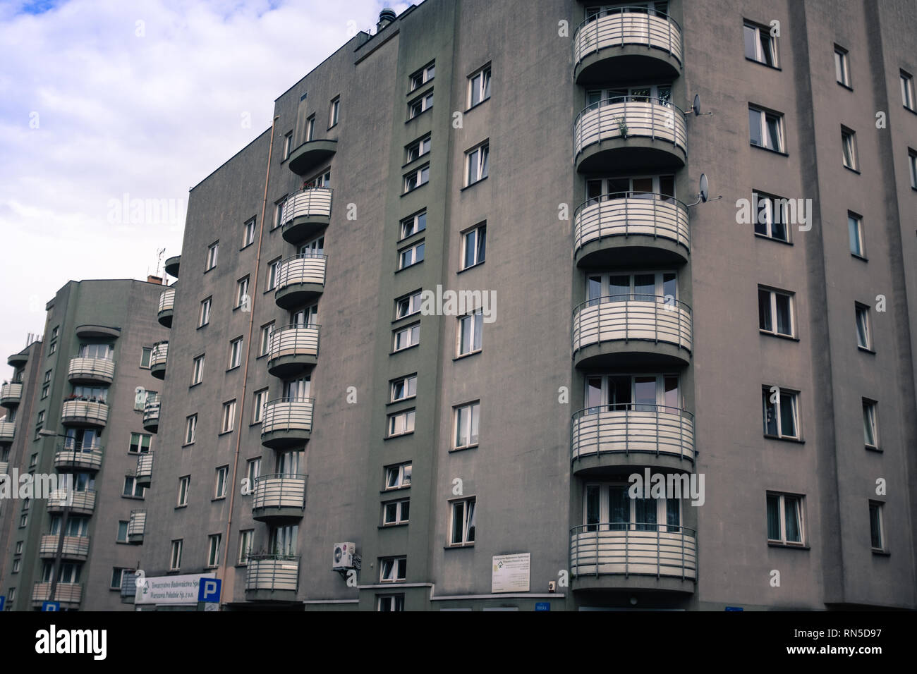Brutalist block of flats with Art Deco balcony Stock Photo