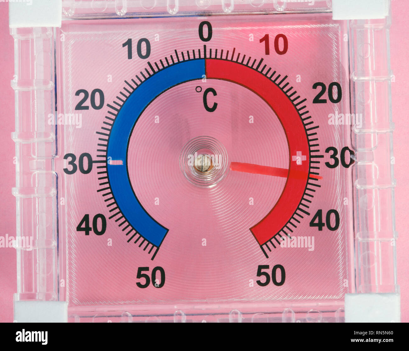 Outdoor Window Wall Thermometer on pink background - Stock Image