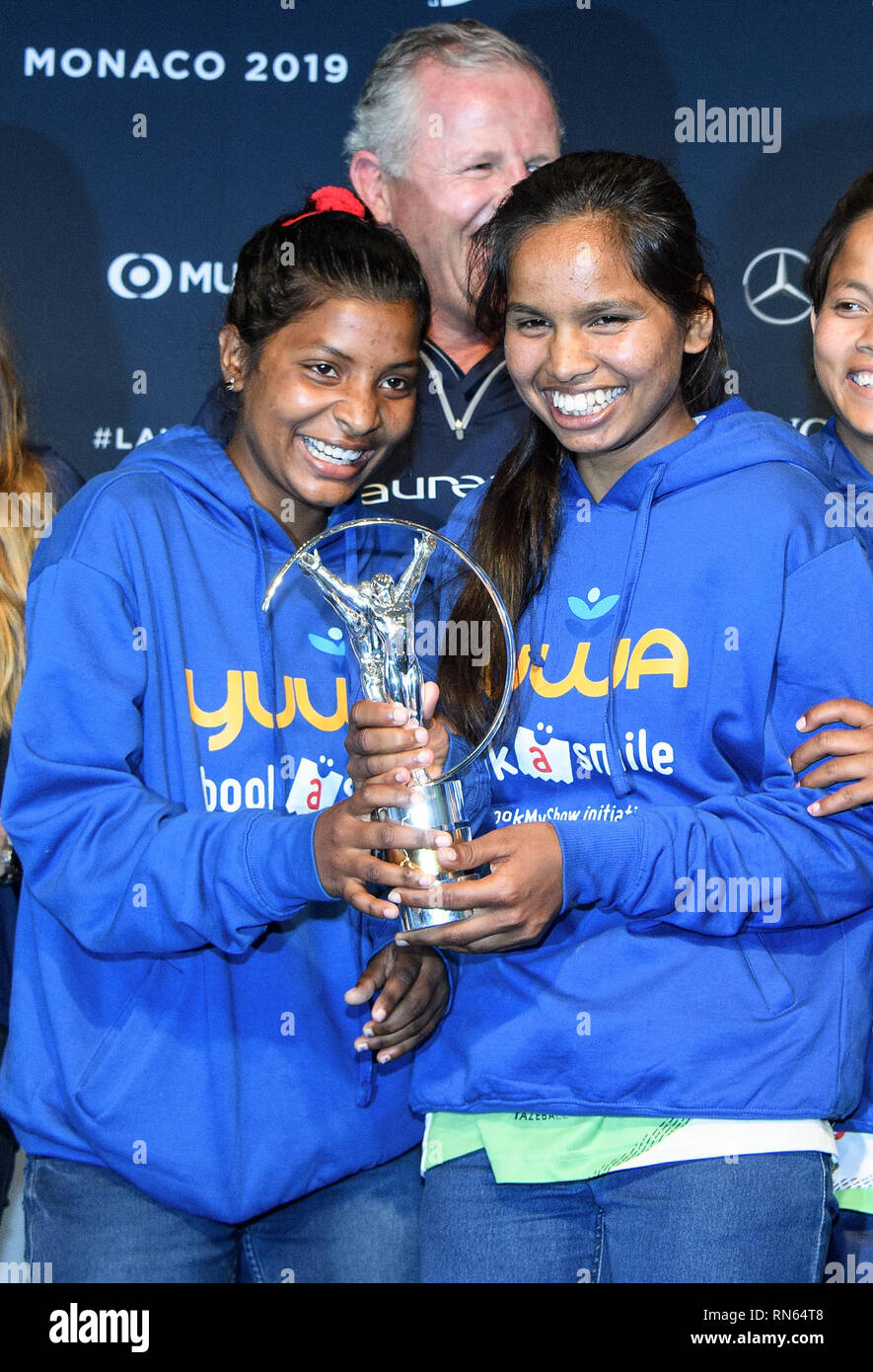 Monaco. 17th Feb, 2019. Prize: Laureus Sport for Good Award 2019: Winner of the trophy is the Indian social sport project Yuwa: The winners left to right Radha and Neeta, football players of the project Yuwa, behind Sean Fitzpatrick (Chairman Laureus). GES/Sports General/Laureus World Sports Awards 2019, 17.02.2019 Sports: Laureus World Sports Awards 2019, February 17, 2019 | usage worldwide Credit: dpa/Alamy Live News - Stock Image