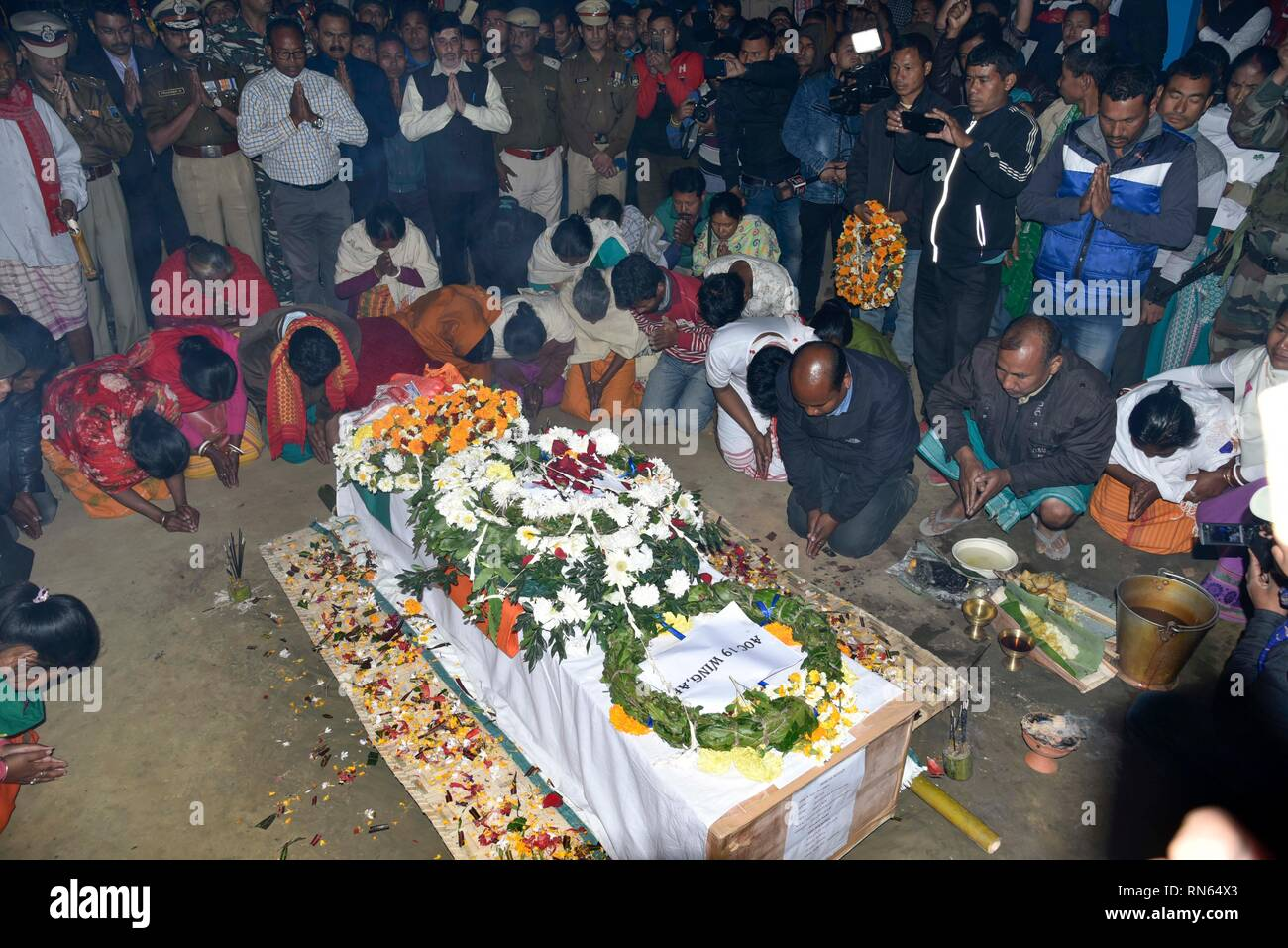 Assam, India. 16th Feb, 2019. Martyr Maneshwar Basumatary. Baksa, Assam, India. 16February 2019. Family members and relatives and others of slain Central Reserve Police Force (CRPF) soldier, Maneshwar Basumatary mourn near his coffin before his cremation ceremony at village Tamulpur in Baksa district, Assam, India, 16 February 2019. At least 44 Indian paramilitary Central Reserve Police Force personnel were killed and several injured when a Jaish-e-Mohammed militant rammed an explosive-laden vehicle into a CRPF convoy along the Srinagar-Jammu highway at Lethpora area in South Kashmir's Pulwama - Stock Image