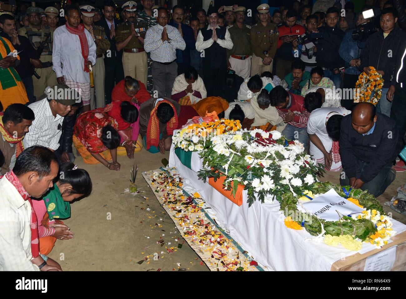 Assam, India. 16th Feb, 2019. Martyr Maneshwar Basumatary. Baksa, Assam, India. 16 February 2019. Family members and relatives and others of slain Central Reserve Police Force (CRPF) soldier, Maneshwar Basumatary mourn near his coffin before his cremation ceremony at village Tamulpur in Baksa district, Assam, India, 16 February 2019. At least 44 Indian paramilitary Central Reserve Police  Force personnel were killed and several injured when a Jaish-e-Mohammed militant rammed an explosive-laden vehicle into a CRPF convoy along the Srinagar-Jammu highway at Lethpora area in South Kashmir's Pulwa - Stock Image