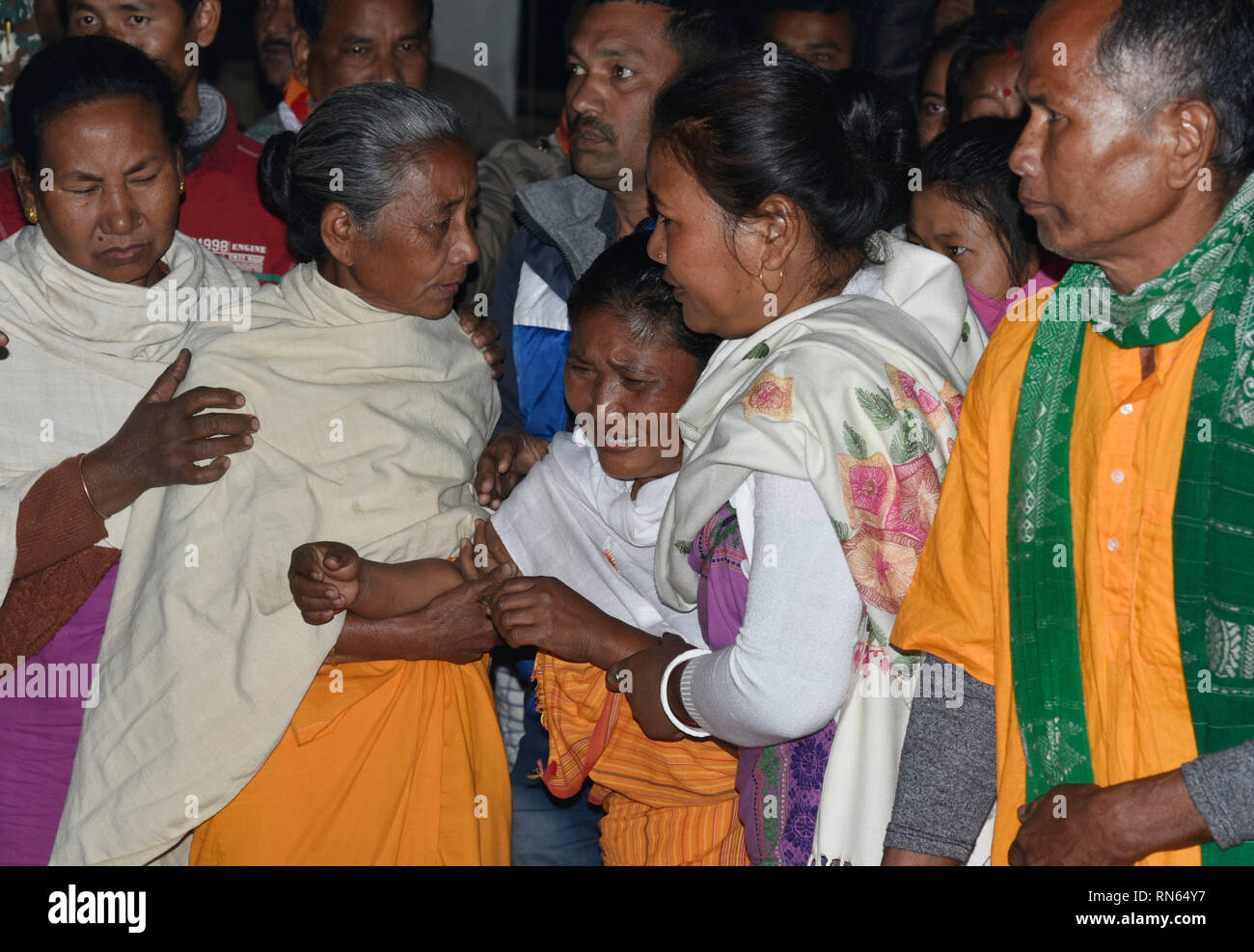 Assam, India. 16th Feb, 2019. Martyr Maneshwar Basumatary. Baksa, Assam, India. 16February 2019. Shanmoti Basumatary (Middle), wife of slain Central Reserve Police Force (CRPF) soldier, Maneshwar Basumatary mourn before his cremation ceremony at village Tamulpur in Baksa district, Assam, India, 16 February 2019. At least 44 Indian paramilitary Central Reserve Police Force personnel were killed and several injured when a Jaish-e-Mohammed militant rammed an explosive-laden vehicle into a CRPF convoy along the Srinagar-Jammu highway at Lethpora area in South Kashmir's Pulwama district on 14 Febru - Stock Image