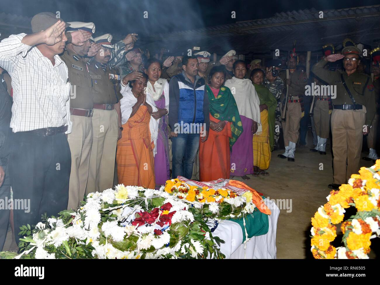 Assam, India. 16th Feb, 2019. Martyr Maneshwar Basumatary. Baksa, Assam, India. 16February 2019. Wife and other family members of slain Central Reserve Police Force (CRPF) soldier, Maneshwar Basumatary mourn near his coffin before his cremation ceremony at village Tamulpur in Baksa district, Assam, India, 16 February 2019. At least 44 Indian paramilitary Central Reserve Police Force personnel were killed and several injured when a Jaish-e-Mohammed militant rammed an explosive-laden vehicle into a CRPF convoy along the Srinagar-Jammu highway at Lethpora area in South Kashmir's Pulwama district  - Stock Image