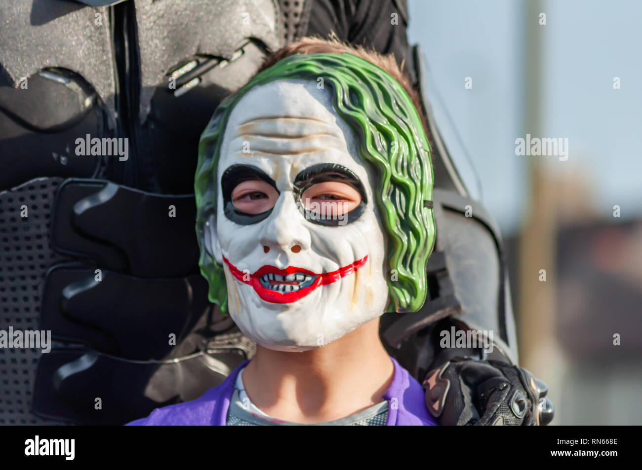 Edinburgh, Scotland, UK. 17th February, 2019. A cosplayer dressed as the fictional supervillain The Joker from the comic books published by DC Comics arriving on day three of the Capital Sci-Fi Con held at the Edinburgh Corn Exchange. Credit: Skully/Alamy Live News - Stock Image