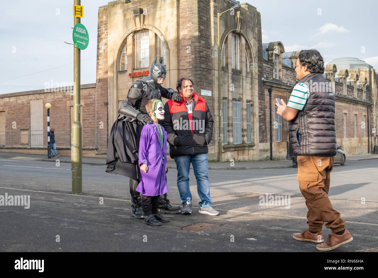 Edinburgh, Scotland, UK. 17th February, 2019. A cosplayer dressed as the fictional superhero Batman alongside the supervillain The Joker from the comic books published by DC Comics arriving on day three of the Capital Sci-Fi Con held at the Edinburgh Corn Exchange. Credit: Skully/Alamy Live News - Stock Image