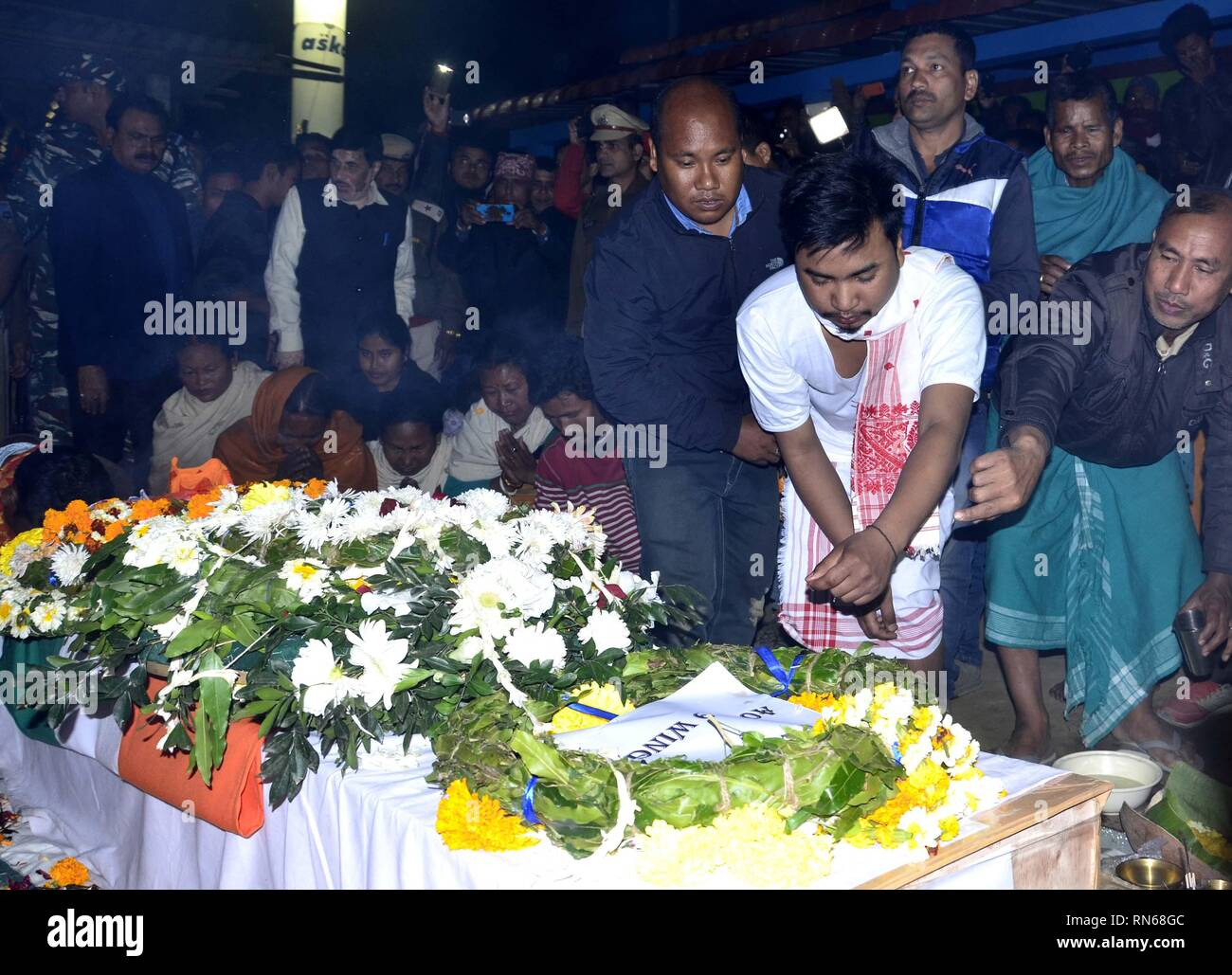 Assam, India. 16th Feb, 2019. Martyrs of Pulwama attack:Baksa,Assam,India:16 February 2019:: Dhananjay Basumatary son of slain CRPF Maneshwar Basumatary  lays wearth on the coffin of  CRPF Jawan Maneshwar Basumatary at Tamulpur In Baksa District , Saturday, Feb. 16, 2019. Credit: Hafiz Ahmed/Alamy Live News - Stock Image