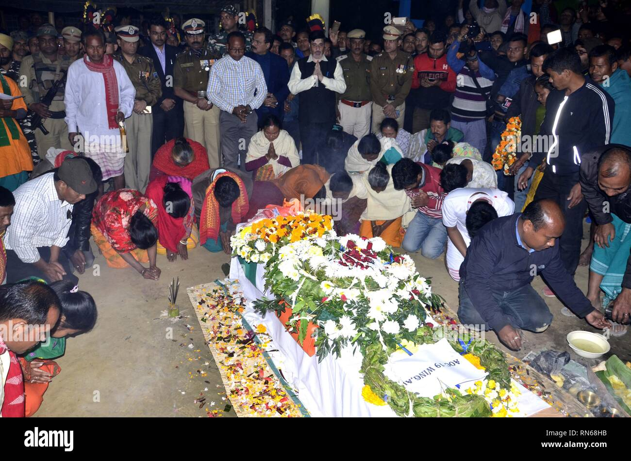 Assam, India. 16th Feb, 2019. Martyrs of Pulwama attack:Baksa,Assam,India:16 February 2019:: Family members pay their final respects to the slain CRPF Maneshwar Basumatary, who lost his life in Thursday's Pulwama terror attack, in Baksa, Saturday, Feb 16, 2019. Credit: Hafiz Ahmed/Alamy Live News - Stock Image