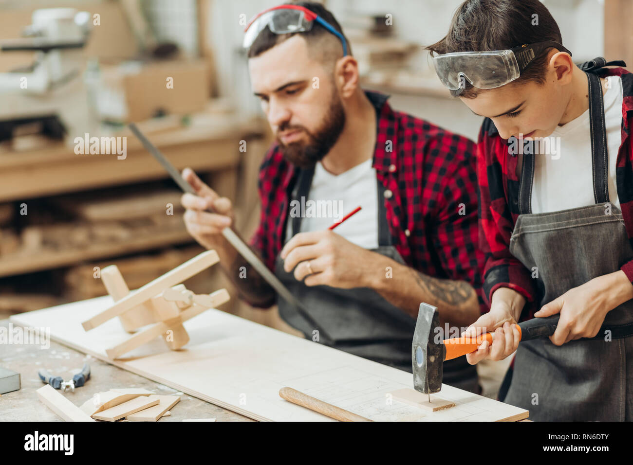 In carpentry coworking studio children and youngsters can learn a useful profession together with Dad. There are carpentry classes for beginners in th Stock Photo