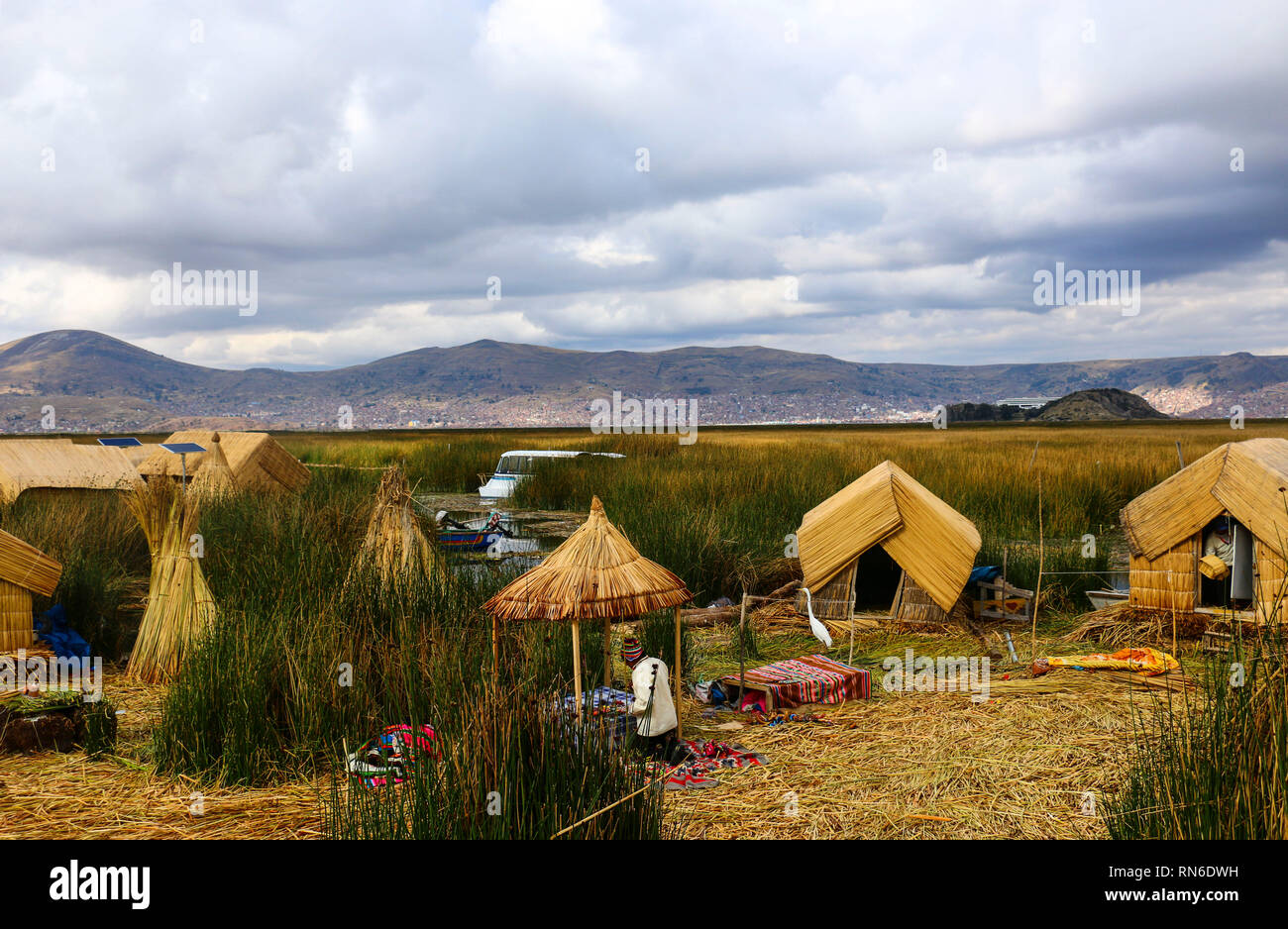 Traditional reed houses on the island Uros, Lake Titicaca, Peru - Stock Image