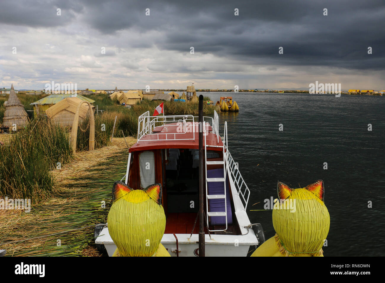 Lake Titicaca view from the boat with the flag of Peru  on the islands Uros, Peru - Stock Image