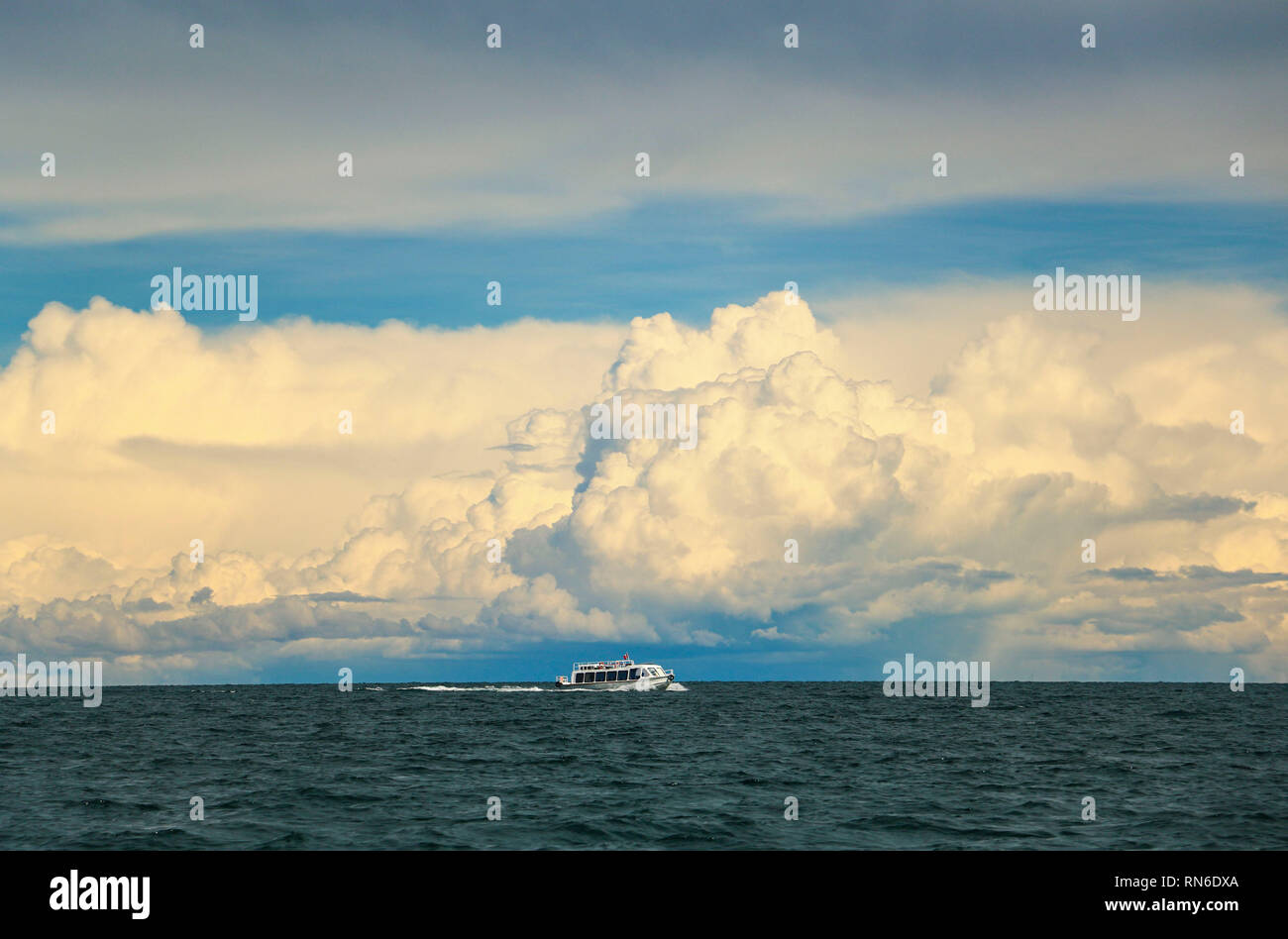 Beautiful view Titicaca lake with a motor boat on the horizon near Puno, Peru, South America - Stock Image