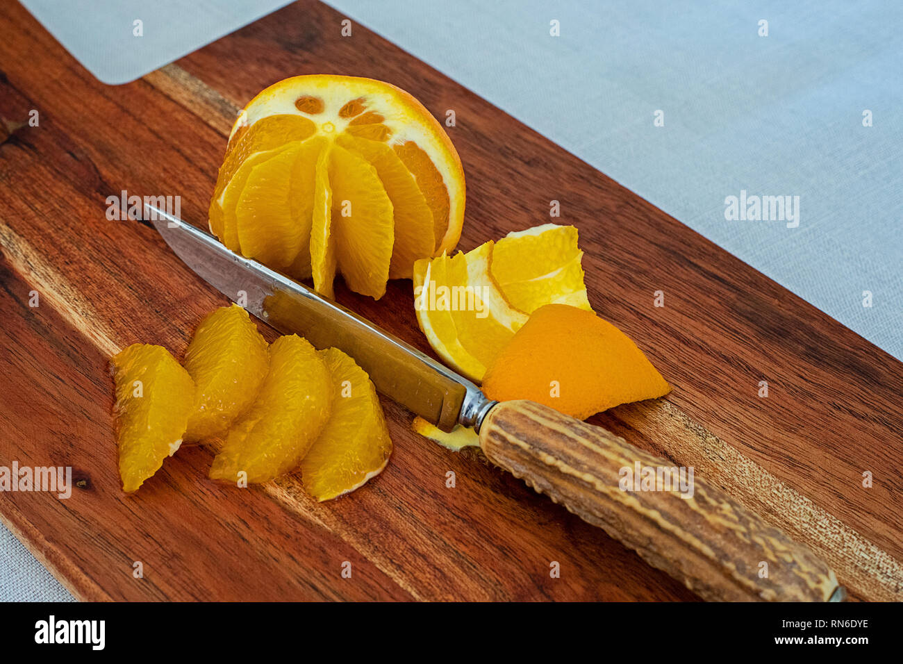 Peel the oranges and fillet them. - Stock Image
