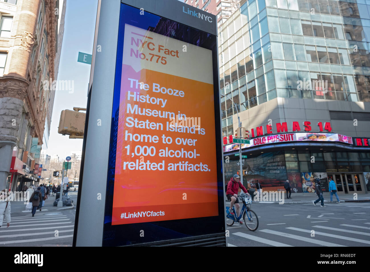 A message on a LINK NYC screen with the fun fact about a Booze History Museum with 1000+ artifacts. Sign on Broadway in Greenwich Village, Manhattan. - Stock Image