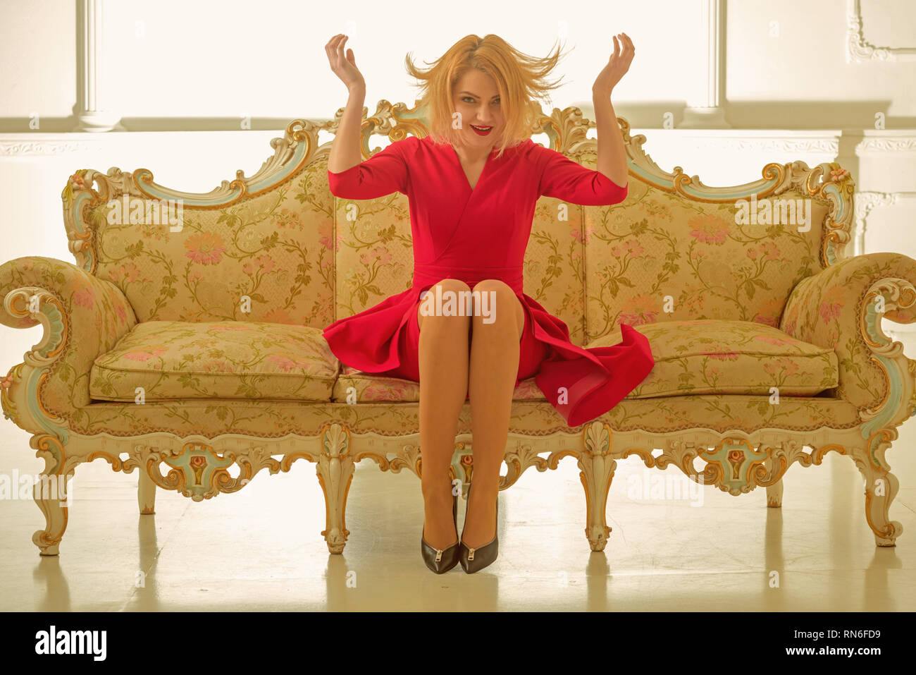 hairdresser salon for a true lady just from hairdresser. perfect hair style at hairdresser studio. woman hairdresser on luxury sofa. she loves her - Stock Image