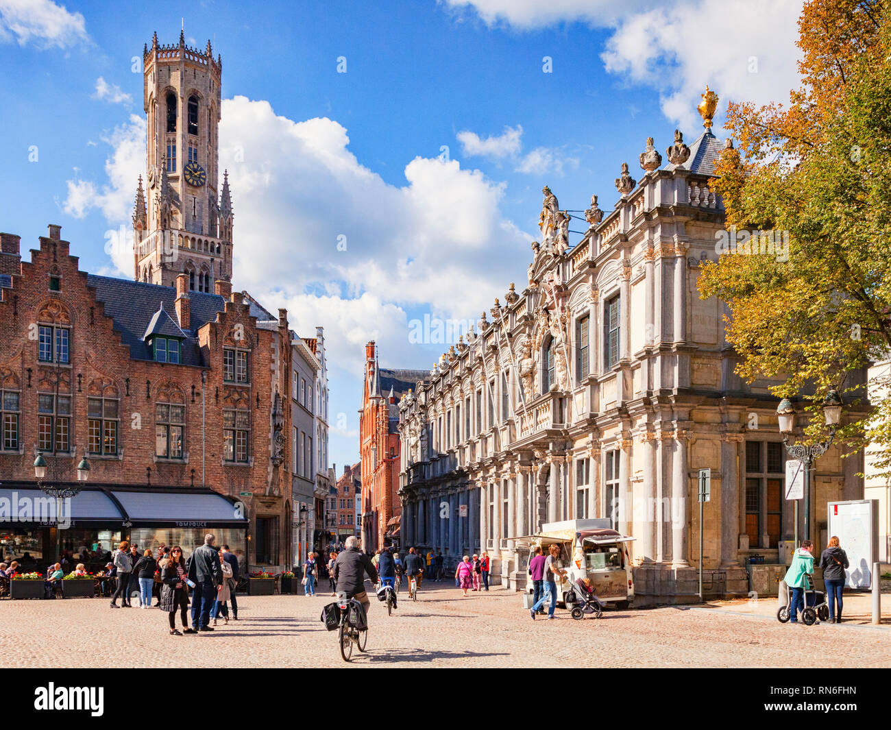 25 September 2018: Bruges, Belgium - View of the Bruges Belfry, or Belfort, from the main square of the city, the Burg. The area is crowded with touri Stock Photo