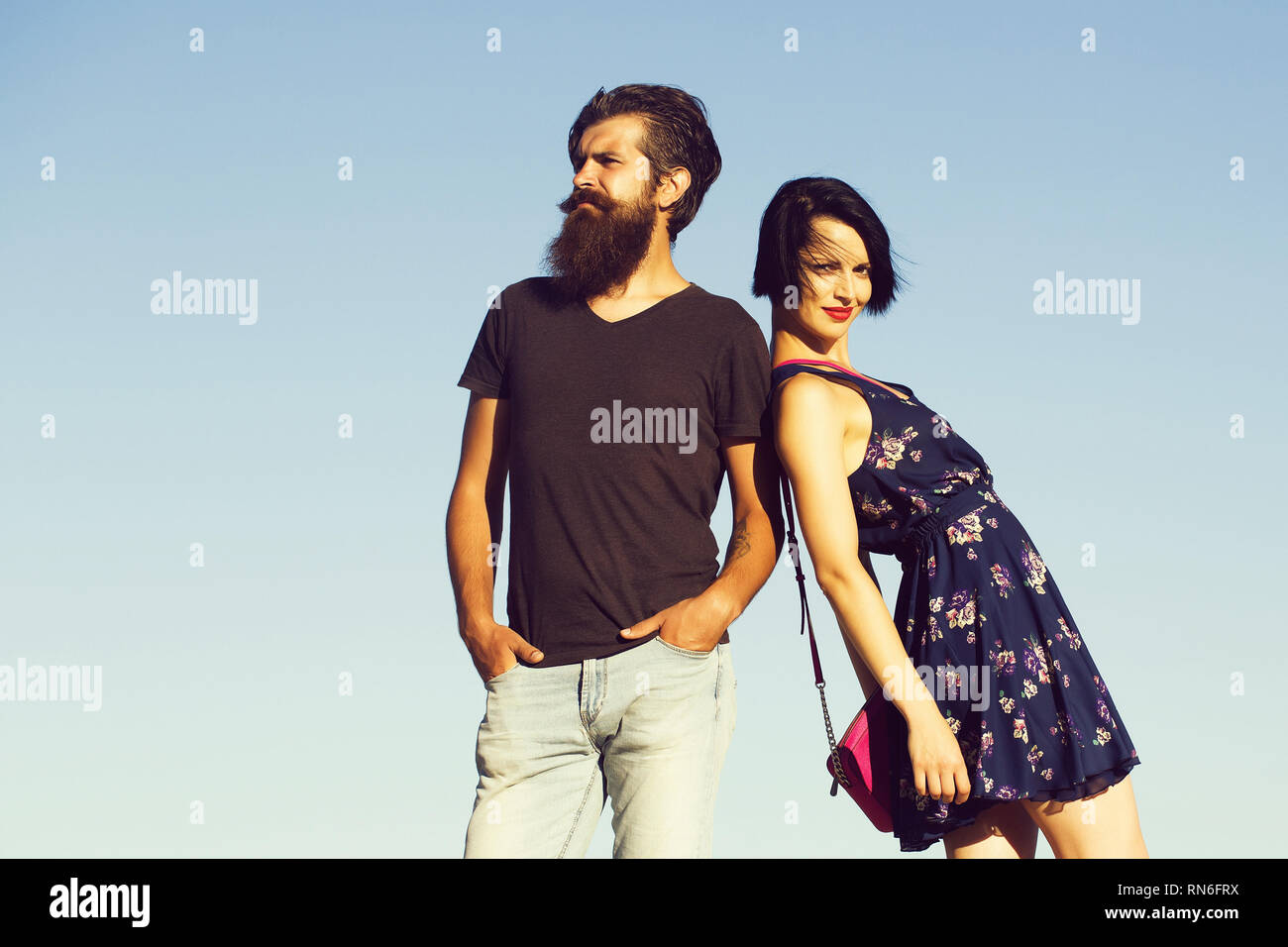 Couple pose on blue sky - Stock Image