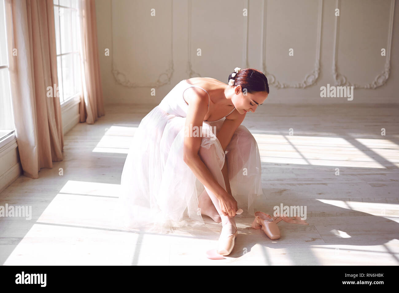 Ballerina wearing pointe shoes in the room Stock Photo