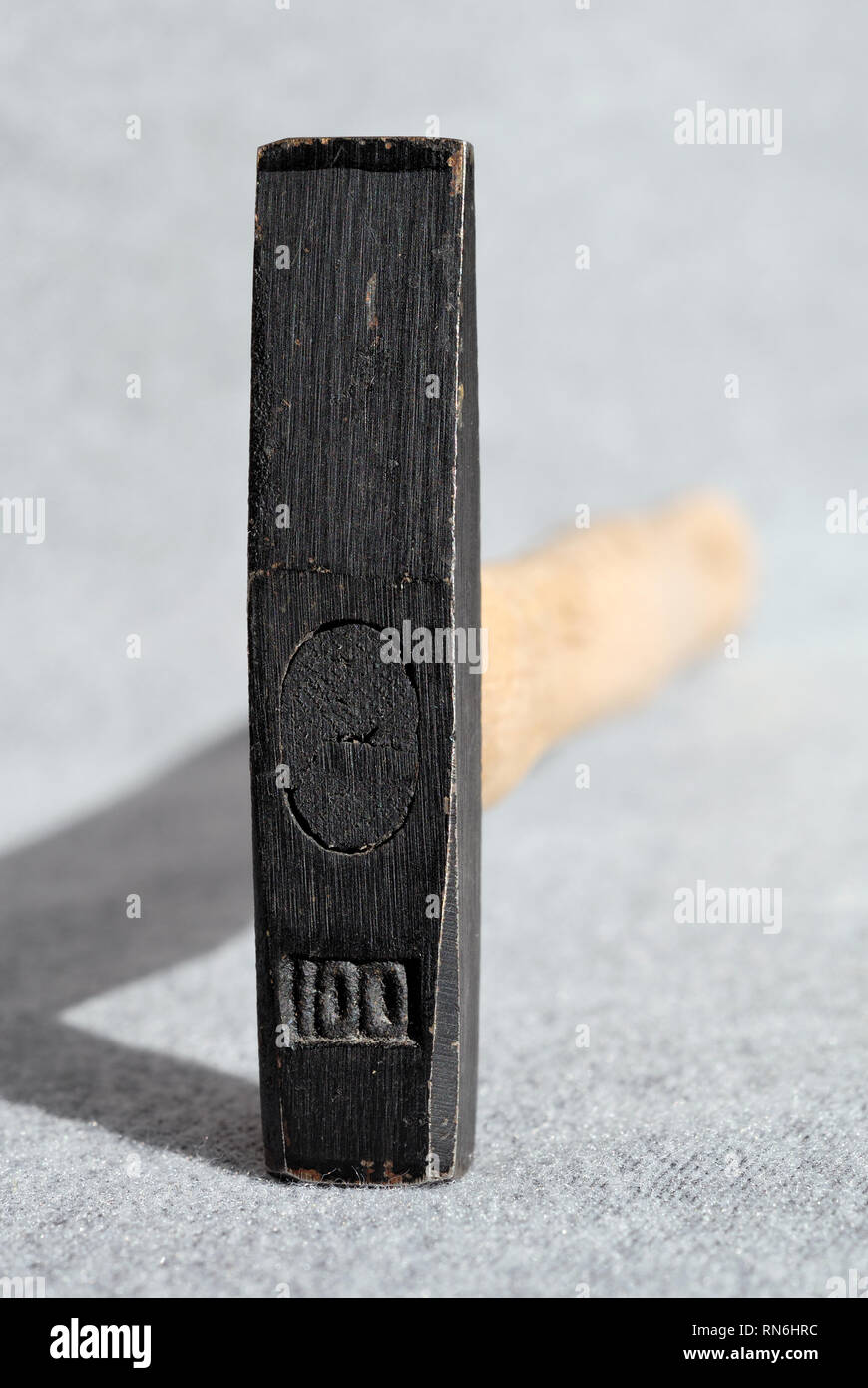Small hammer for housework closeup. Shallow depth of field - Stock Image
