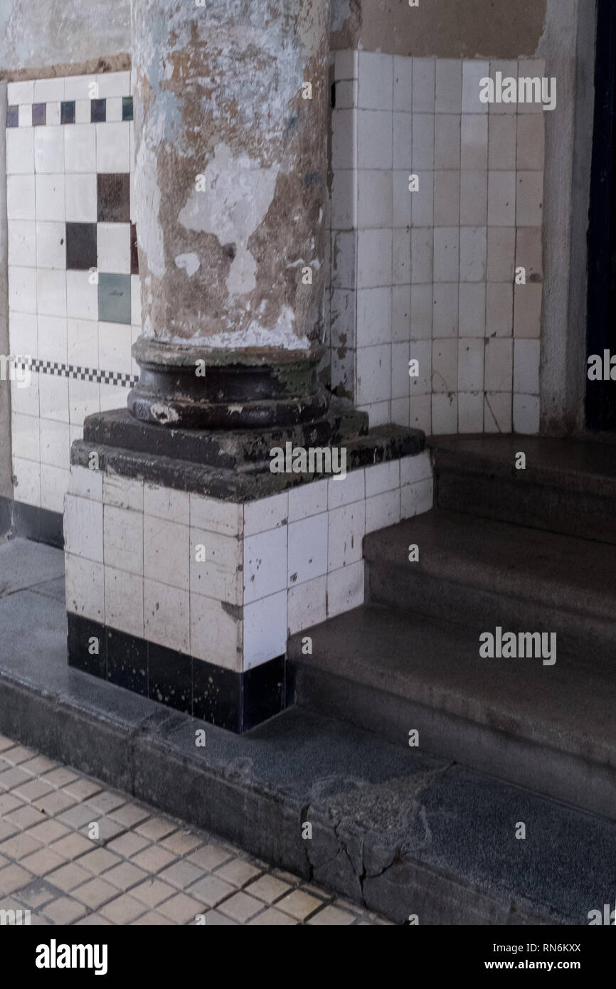 tiled pillar with steps leading to a building Stock Photo