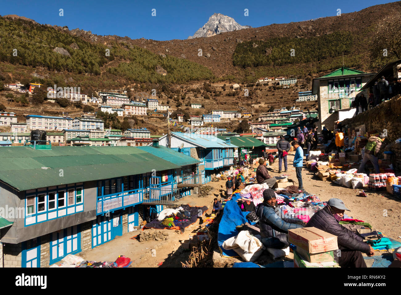 Nepal, Namche Bazaar, Market, local shoppers and traders in sunshine - Stock Image