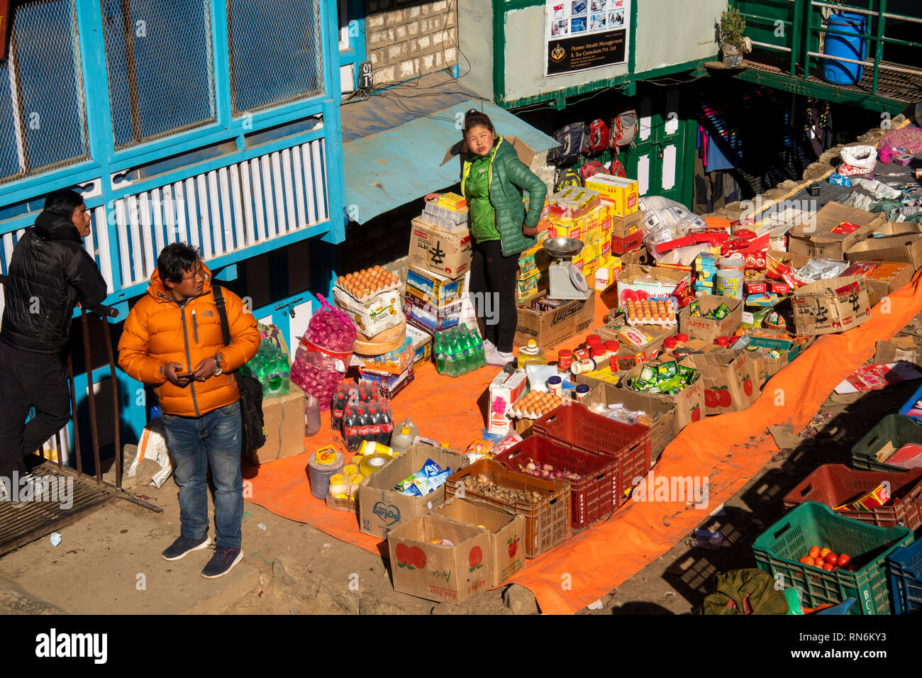 Nepal, Namche Bazaar, Market, elevated view of household goods, eggs and packaged food on display - Stock Image
