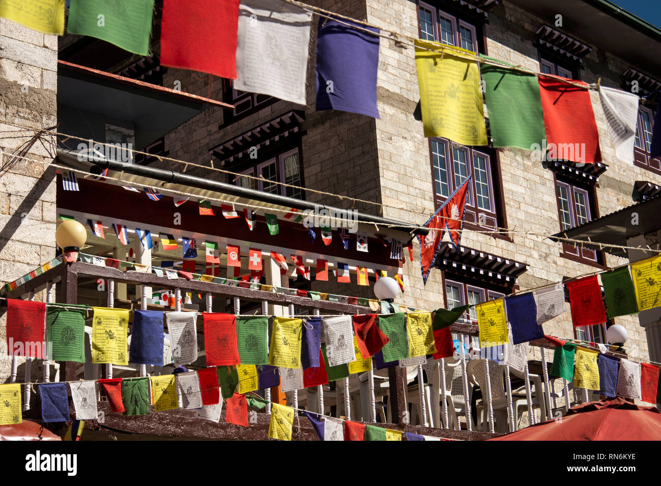 Nepal, Namche Bazaar, religion, colourful Buddhist prayer flags above main street through the town - Stock Image