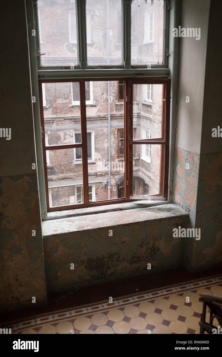 view through a tenement blocks window of a tenement block in Poland Stock Photo