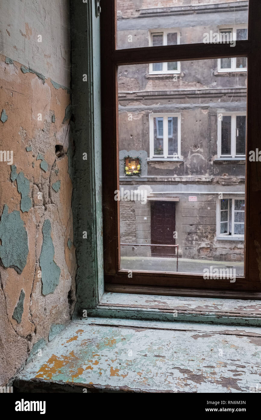 flowers in a window box in an old tenement house Stock Photo