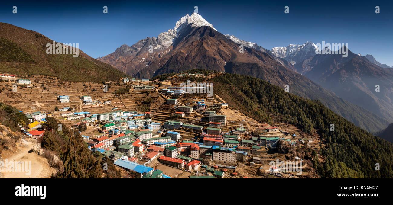Np994Nepal, Namche Bazaar, snow capped Thamserkhu and Kusum Kangaru peaks above the town, panoramic - Stock Image