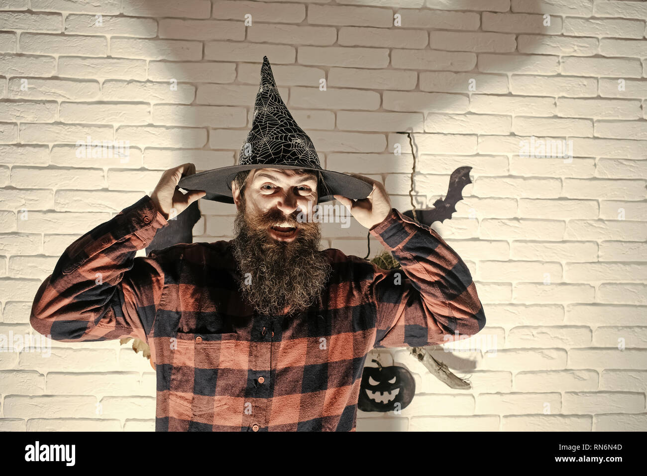 9418f8c704096 Halloween hipster with beard on evil face and witch hat Stock Photo ...