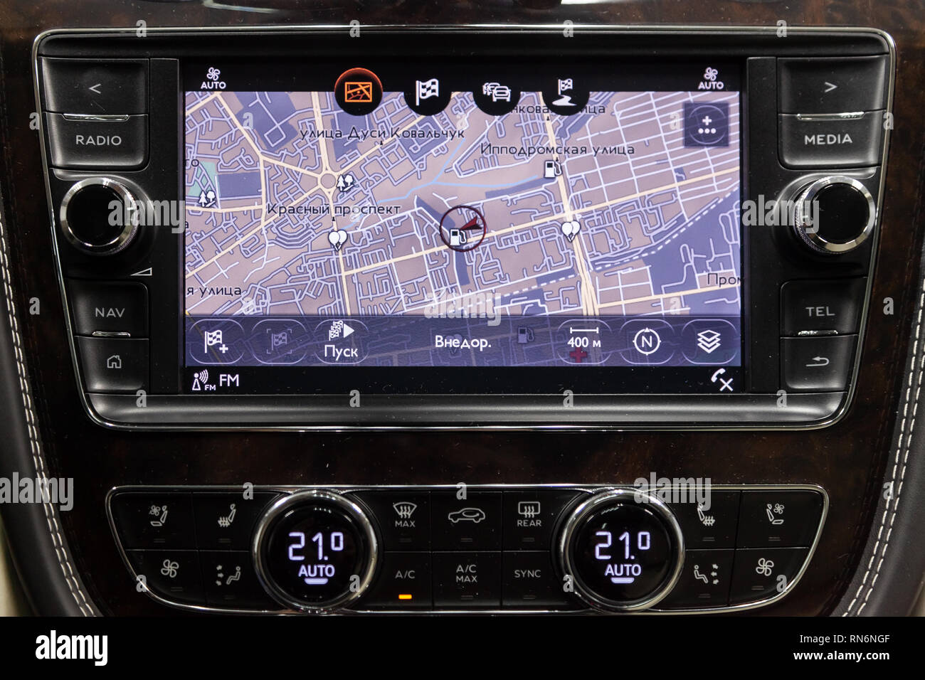 Novosibirsk, Russia - 08.01.18: Interior view with multimedia system navigation and emblem of luxury very expensive new black Bentley Bentayga car sta - Stock Image